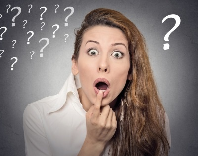 Surprise astonished woman. Headshot portrait woman looking surprised in disbelief wide open mouth isolated grey wall background. Human emotion face expression body language. Funny girl with question.jpeg